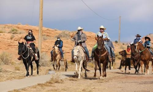 A group of Native Americans on the Navajo Nation ride on horseback to the polls on election day in Kayenta, Arizona.