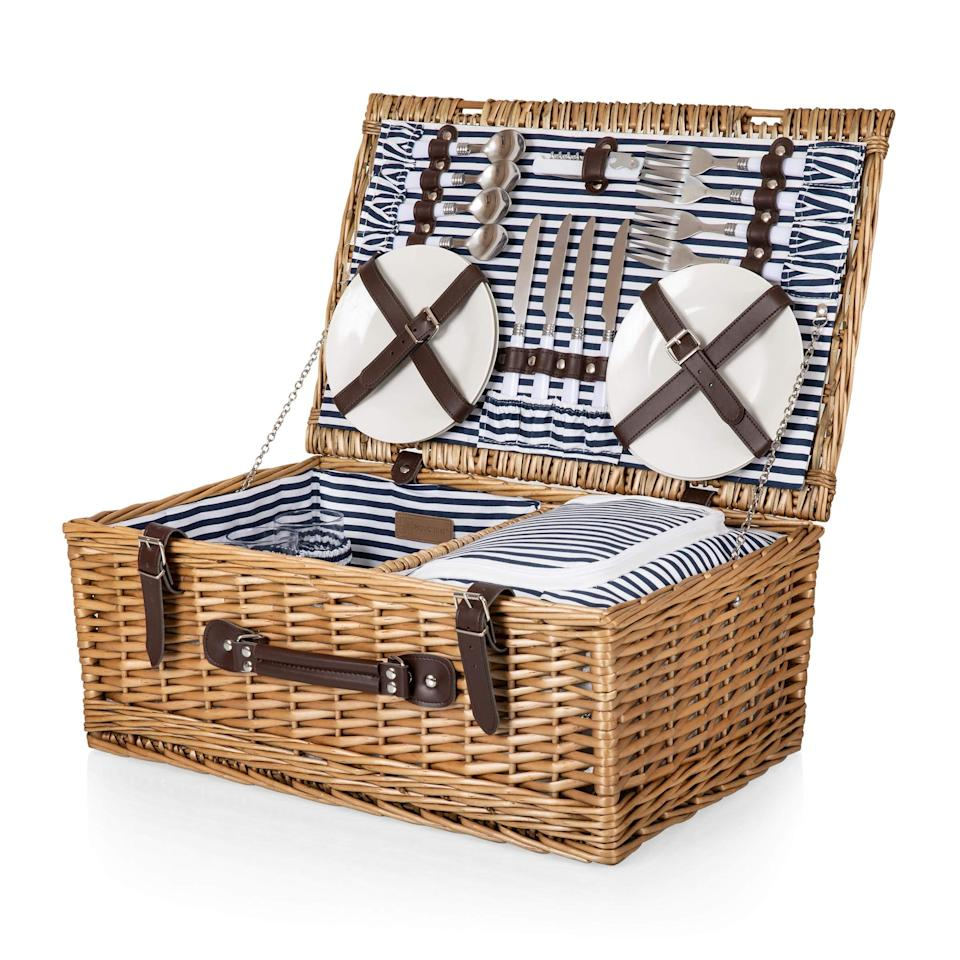 """<h3><a href=""""https://amzn.to/2ClbxXC"""" rel=""""nofollow noopener"""" target=""""_blank"""" data-ylk=""""slk:Picnic Time Wicker Basket"""" class=""""link rapid-noclick-resp"""">Picnic Time Wicker Basket<br></a></h3> <br>We all know that sharing is caring, but that rule doesn't really apply in these unusual coronavirus times. To avoid any sort of cross-contamination during your picnic, opt for a basket that comes with four separate sets of plates, wine glasses, knives, forks, and spoons. <br><br><strong>Picnic Time</strong> Belmont Wicker Picnic Basket with Deluxe Service for Four, Navy/White Stripe, $, available at <a href=""""https://amzn.to/30U3MCj"""" rel=""""nofollow noopener"""" target=""""_blank"""" data-ylk=""""slk:Amazon"""" class=""""link rapid-noclick-resp"""">Amazon</a><br>"""