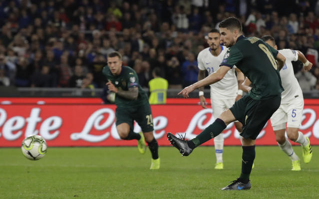 Italy's Jorginho shoots and scores the opening goal of the game from the penalty spot during the Euro 2020 group J qualifying soccer match between Italy and Greece in Rome, Italy, Saturday, Oct. 12, 2019. (AP Photo/Alessandra Tarantino)