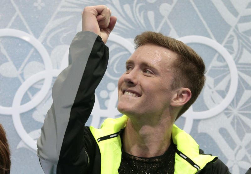 Jeremy Abbott of the United States gestures as he sits in the results area after the men's free skate figure skating final at the Iceberg Skating Palace at the 2014 Winter Olympics, Friday, Feb. 14, 2014, in Sochi, Russia. (AP Photo/Ivan Sekretarev)