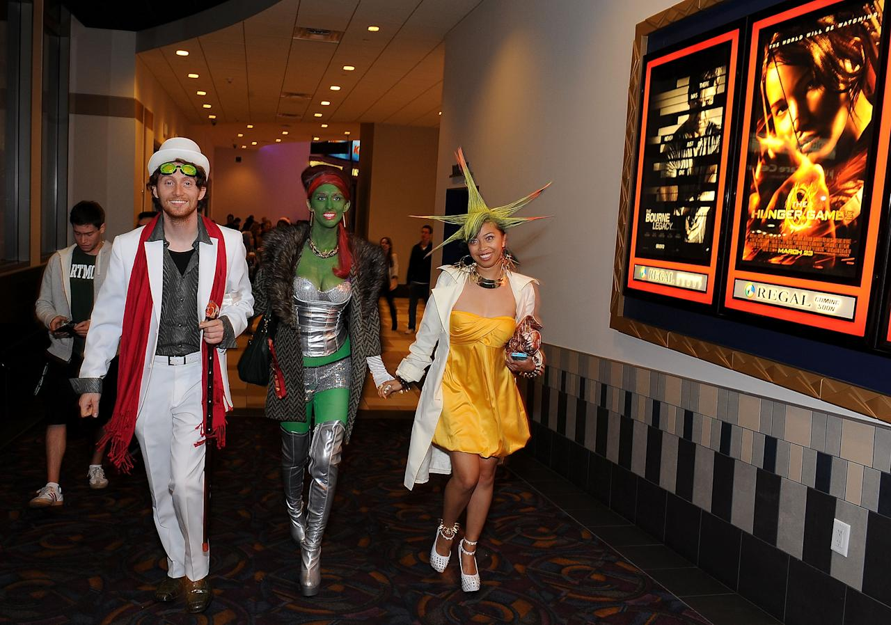 """LOS ANGELES, CA - MARCH 22:  Fans arrive at the Opening Night Of Lionsgate's """"The Hunger Games"""" at the Regal Cinemas L.A. LIVE Stadium on March 22, 2012 in Los Angeles, California.  (Photo by Valerie Macon/Getty Images)"""