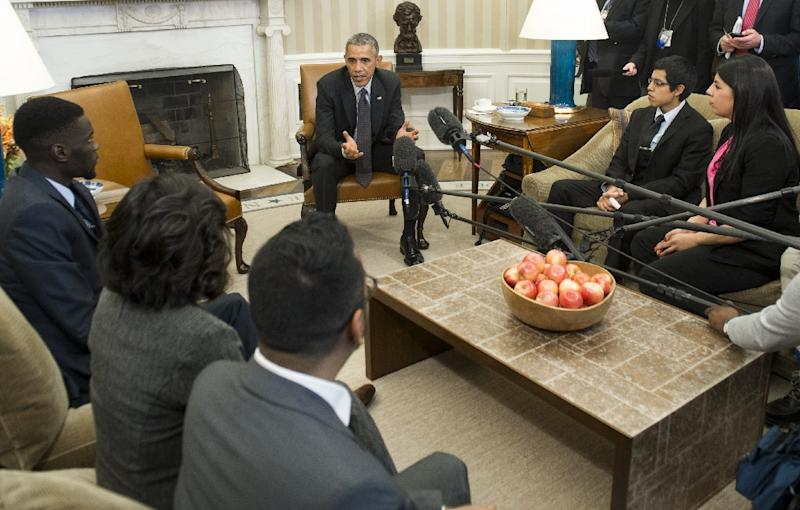 US President Barack Obama speaks about immigration reform during a meeting with young immigrants, in the Oval Office of the White House in Washington, DC, February 4, 2015