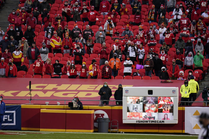 Fans watch from the stands during the second half of an NFL divisional round football game between the Kansas City Chiefs and the Cleveland Browns, Sunday, Jan. 17, 2021, in Kansas City. (AP Photo/Jeff Roberson)