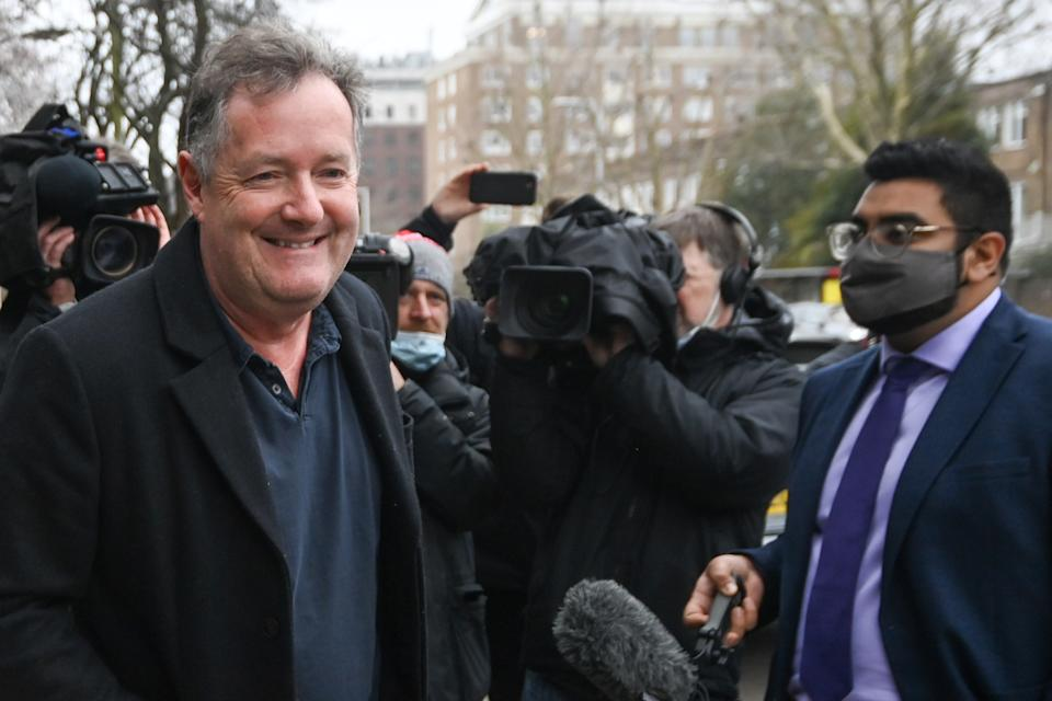 Journalist and television presenter Piers Morgan smiles in front of members of the media as he takes his daughter Elise to school, after he left his high-profile breakfast slot with the broadcaster ITV, following his long-running criticism of Prince Harry's wife Meghan, in London, Britain, March 10, 2021. REUTERS/Toby Melville