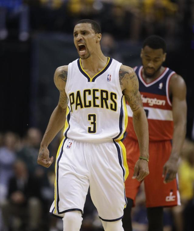 Indiana Pacers' George Hill (3) celebrates during the second half of game 2 of the Eastern Conference semifinal NBA basketball playoff series against the Washington Wizards Wednesday, May 7, 2014, in Indianapolis. Indiana defeated Washington 86-82. (AP Photo/Darron Cummings)