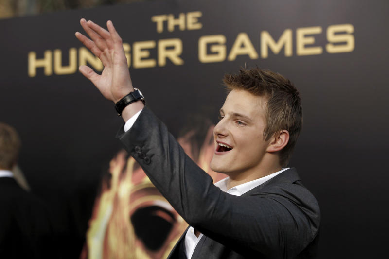"Alexander Ludwig arrives at the world premiere of ""The Hunger Games"" on Monday March 12, 2012 in Los Angeles. (AP Photo/Matt Sayles)"