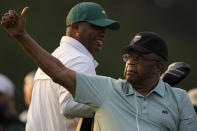 Lee Elder gestures as he arrives for the ceremonial tee shots before the first round of the Masters golf tournament on Thursday, April 8, 2021, in Augusta, Ga. (AP Photo/Charlie Riedel)