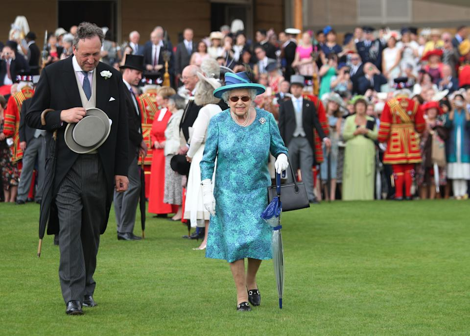 Britain's Queen Elizabeth II arrives for a garden party at Buckingham Palace in London on May 31, 2018. (Photo by Yui Mok / POOL / AFP)        (Photo credit should read YUI MOK/AFP via Getty Images)