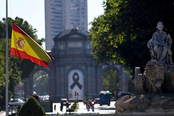 PHOTO: The Spanish flag flies at half-mast in Madrid on May 27, 2020, on the first day of the official 10 days of public mourning for the victims of the coronavirus pandemic. (Gabriel Bouys/AFP via Getty Images)