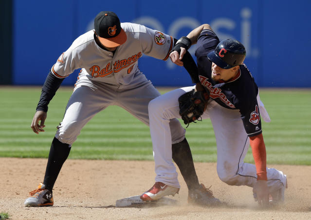 Cleveland Indians' Bradley Zimmer, right, slides safely into second base for a steal as Baltimore Orioles' Jonathan Schoop is late with the tag in the sixth inning of a baseball game, Saturday, Sept. 9, 2017, in Cleveland. (AP Photo/Tony Dejak)