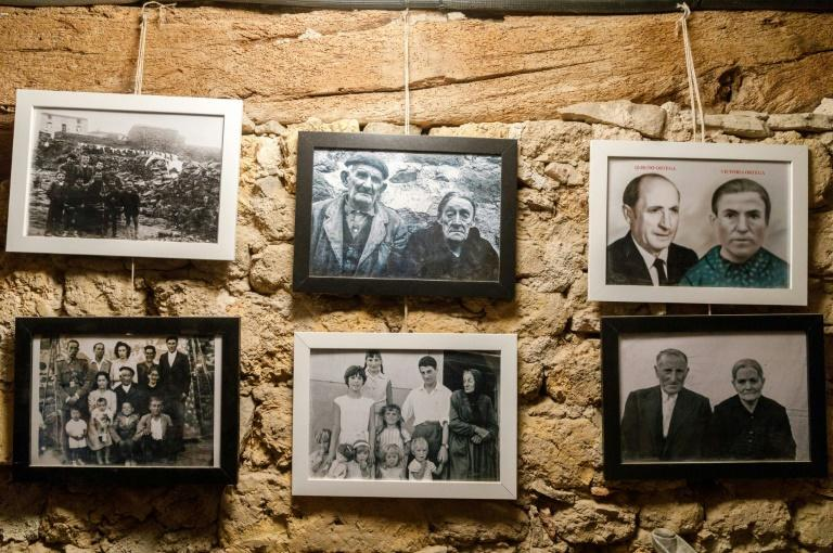 Former inhabitants' photos adorn the wall of the Friends of Sarnago association museum