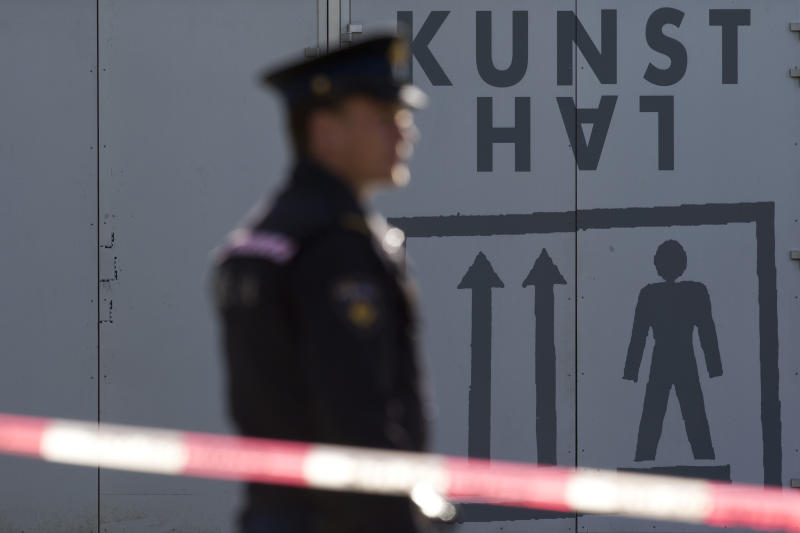 "Police guard the cordoned off perimeter as three markings, left, are seen on a door after fingerprints were taken by forensic experts at Kunsthal museum in Rotterdam, Tuesday Oct. 16, 2012. Several paintings have been stolen from a museum in the Dutch city of Rotterdam that was exhibiting works by Pablo Picasso, Henri Matisse and Vincent van Gogh. At least several paintings were stolen early Tuesday morning from the Kunsthal museum , but their names have not yet been released. They are believed to include at least one by Henri Matisse, the 1919 ""Reading Girl."" (AP Photo/Peter Dejong)"