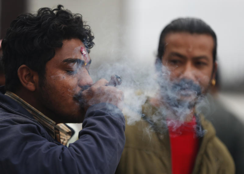 "A Nepalese smokes marijuana during Shivaratri festival at the premises of Pashupatinath temple in Kathmandu, Nepal, Friday, Feb. 21, 2020. Hindu holy men were joined by devotees and the public Friday at a revered temple in Kathmandu where they lit up marijuana cigarettes during an annual festival despite prohibition and warning by authorities. Hindu holy men were joined by devotees and the public Friday at a revered temple in Kathmandu where they lit up marijuana cigarettes during an annual festival despite prohibition and warning by authorities. ""There is a ban on smoking marijuana but at the same time it is centuries-old tradition which we have to respect,""said police officer Suman Khadka adding there was no arrests made Friday. (AP Photo/Niranjan Shrestha)"