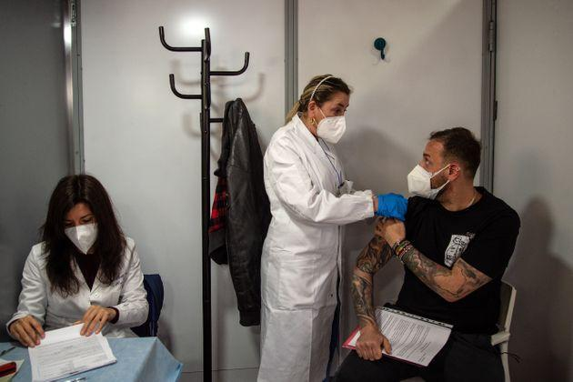 NAPLES, ITALY - APRIL 29: A man receives a dose of a Covid-19 vaccine from a healthcare professional at a mobile vaccination center on April 29, 2021 in Naples, Italy. A mobile vaccination center, set up with the aid of temporary units in the parking lot of the San Gennaro hospital, has opened in the populous Sanità district in Naples. Following delays, the recently updated Covid-19 vaccination plan will see 62 million doses being delivered to Italy in the second trimester of 2021. (Photo by Ivan Romano/Getty Images) (Photo: Ivan Romano via Getty Images)