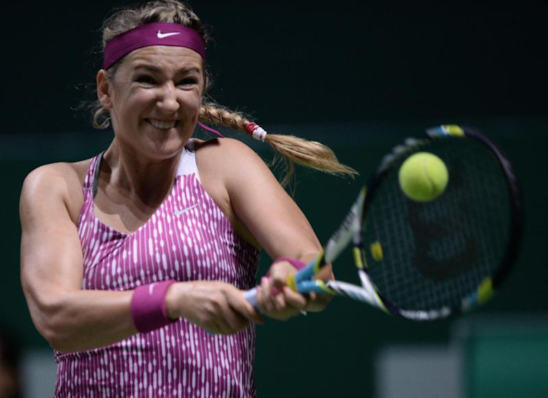 Victoria Azarenka of Belarus returns a shot to Jelena Jankovic of Serbia during their tennis match at the WTA championship in Istanbul, Turkey, Wednesday, Oct. 23, 2013. The world's top female tennis players compete in the championships which runs from Oct. 22 until Oct. 27.(AP Photo)