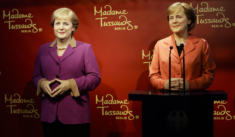 A new wax figure of German Chancellor Angela Merkel, left, is presented to the media next to a wax figure from 2005, right, at Madame Tussauds in Berlin, Germany, Thursday, Sept. 19, 2013. Germany faces general elections on Sept. 22, 2013 where Chancellor and Christian Democratic Union, CDU, party chairwoman Merkel will run for her third term. (AP Photo/Markus Schreiber)