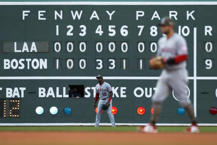 Los Angeles Angels' Justin Upton (10) and David Fletcher play against the Boston Red Sox during the eighth inning of a baseball game, Saturday, May 15, 2021, in Boston. (AP Photo/Michael Dwyer)