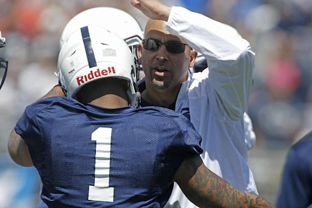 Penn State head coach James Franklin, right, greets running back Bill Belton (1) during warmups before the annual Blue-White NCAA college football scrimmage on Saturday, April 12, 2014, in State College, Pa. (AP Photo/Keith Srakocic)
