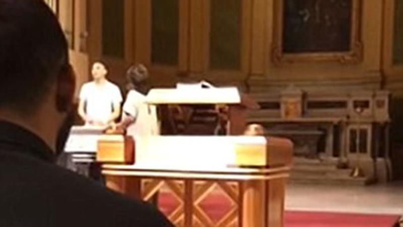 The man can be seen ranting in front of the church organ. Source: YouTube