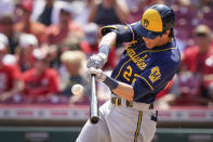 Milwaukee Brewers' Christian Yelich (22) hits a home run during the seventh inning of a baseball game against the Cincinnati Reds in Cincinnati, Sunday, July 18, 2021. (AP Photo/Bryan Woolston)