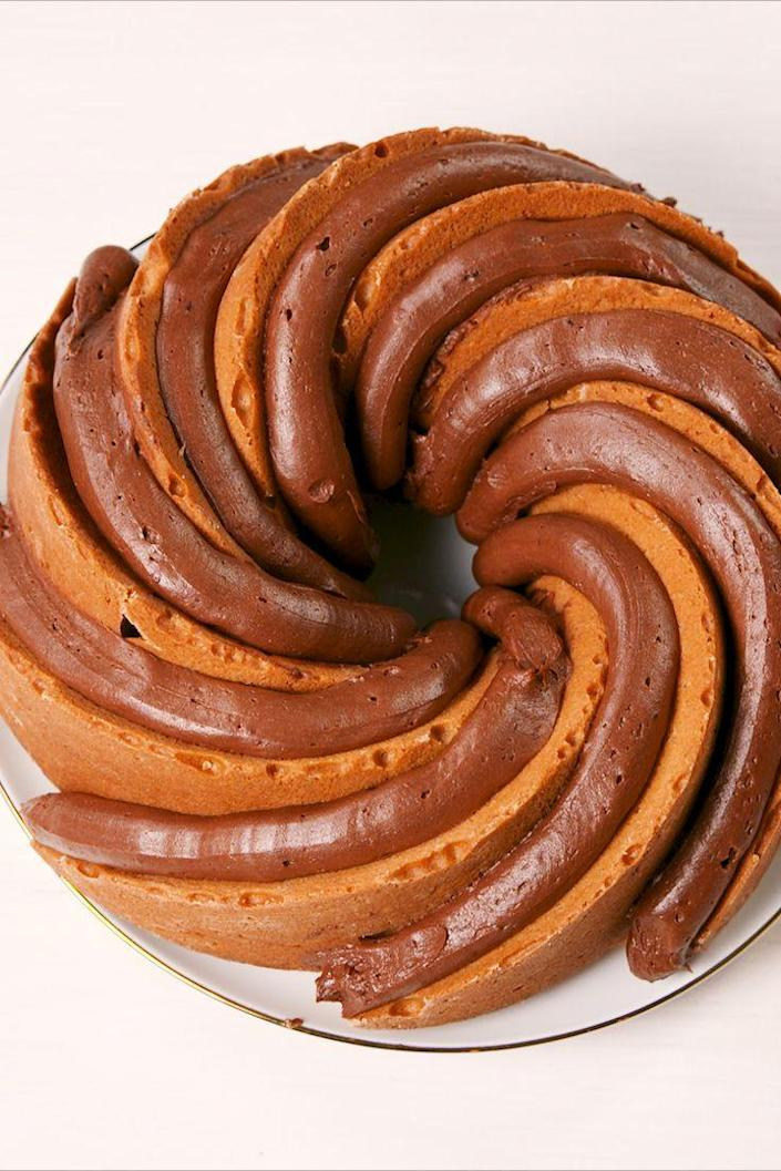 """<p>Reese's lovers—this one's for you.</p><p>Get the recipe from <a href=""""https://www.delish.com/cooking/recipe-ideas/a21347444/chocolate-peanut-butter-bundt-cake-recipe/"""" rel=""""nofollow noopener"""" target=""""_blank"""" data-ylk=""""slk:Delish"""" class=""""link rapid-noclick-resp"""">Delish</a>.</p>"""