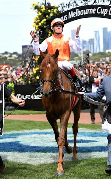 Veteran jockey Craig Williams celebrates his Melbourne Cup win on Vow and Declare