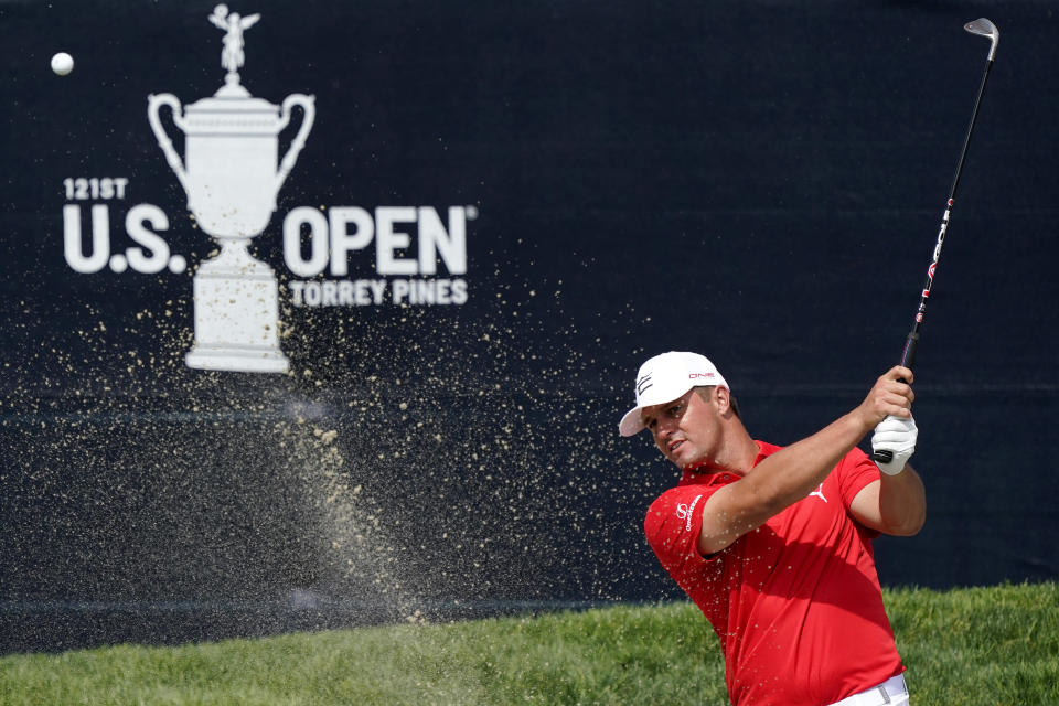 Bryson DeChambeau hits from the 18th green bunker during a practice round of the U.S. Open Golf Championship, Tuesday, June 15, 2021, at Torrey Pines Golf Course in San Diego. (AP Photo/Marcio Jose Sanchez)