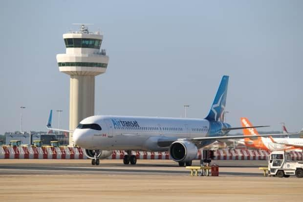 In a sign of hope for a beleaguered travel industry, Air Transat returned to the United Kingdom this week, with the Canadian carrier's airplanes landing at Gatwick Airport south of London for the first time since flights were suspended 11 months ago. (Stephanie Jenzer/CBC - image credit)