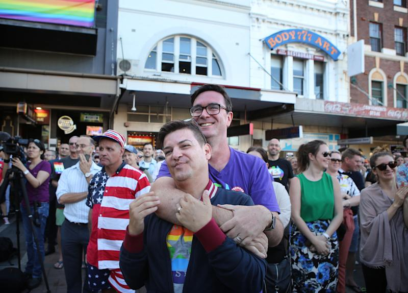 Victor De Sousa (left) and Chris Murray share the moment in Taylor Square in Sydney. (James Alcock via Getty Images)