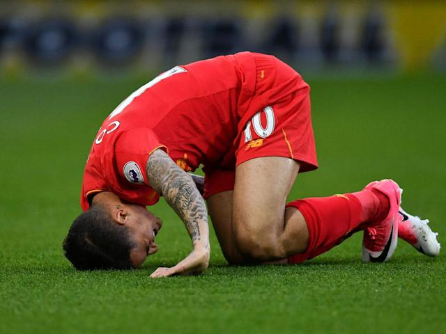Coutinho reacts after being ran into by Mariappa (Getty)
