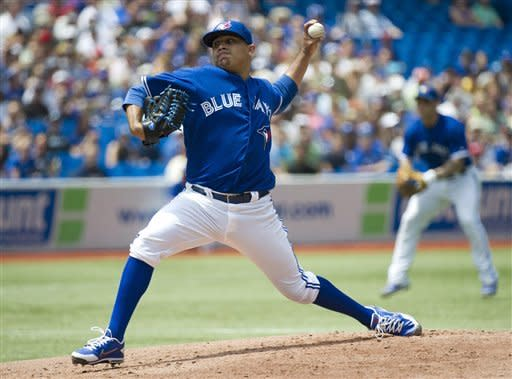 Toronto Blue Jays starting pitcher Ricky Romero throws against the Philadelphia Phillies during first inning of a baseball game in Toronto on Saturday, June 16, 2012. (AP Photo/The Canadian Press, Nathan Denette)