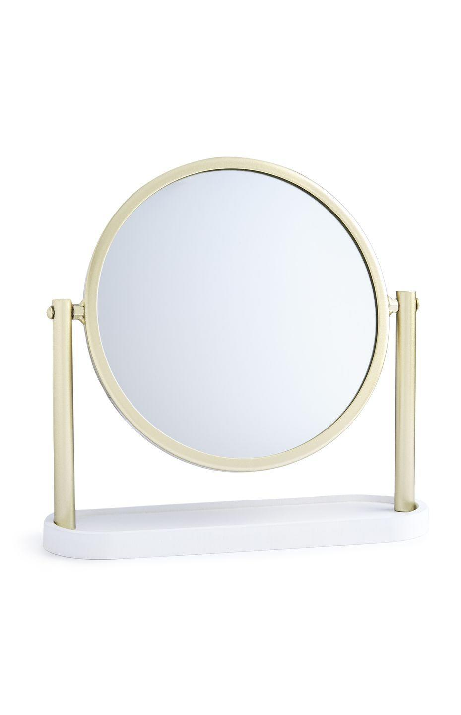 <p>Small standing mirror in gold, price unknown</p>