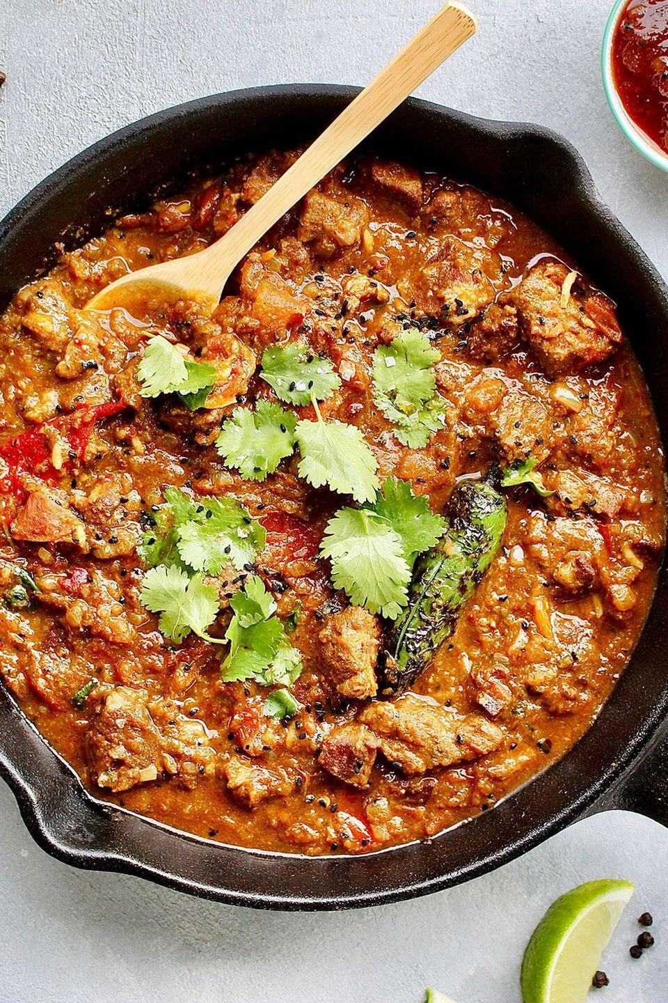 """<p>Why is this our favourite? The combinations of ingredients make a flavour that's hard to resist. It has a good amount of heat, while the sweet tomatoes, combined with the thick, rich, gravy-like sauce, is pretty moreish. </p><p>Get the <a href=""""https://www.delish.com/uk/cooking/recipes/a33642009/lamb-karahi/"""" rel=""""nofollow noopener"""" target=""""_blank"""" data-ylk=""""slk:Lamb Karahi"""" class=""""link rapid-noclick-resp"""">Lamb Karahi</a> recipe.</p>"""