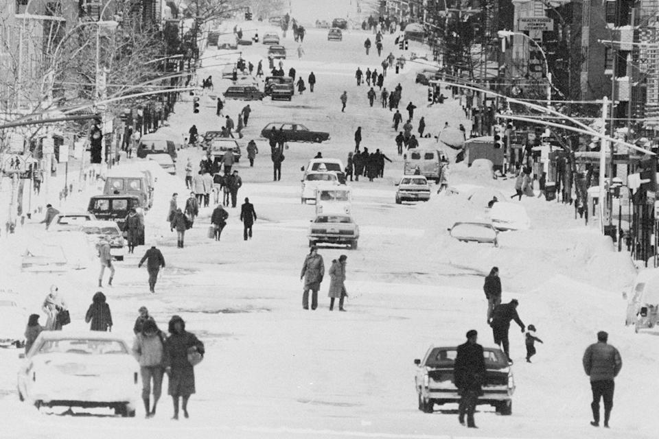 <p>Pedestrians get around the city any way they can, as sidewalks pile up with snow from a blizzard.</p>