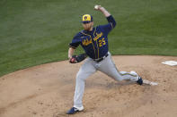 Milwaukee Brewers starting pitcher Brett Anderson delivers during the first inning of a baseball game against the Chicago Cubs Thursday, Aug. 13, 2020, in Chicago. (AP Photo/Jeff Haynes)