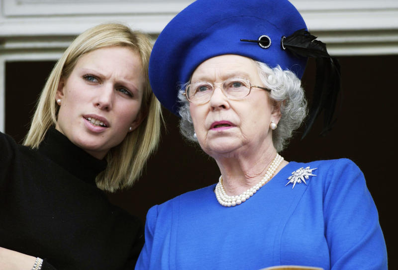 CHELTENHAM - MARCH 3: Queen Elizabeth II and Zara Phillips at the Cheltenham Gold Cup on March 3, 2003, in Chltenham, England. (Photo by Anwar Hussein/Getty Images)
