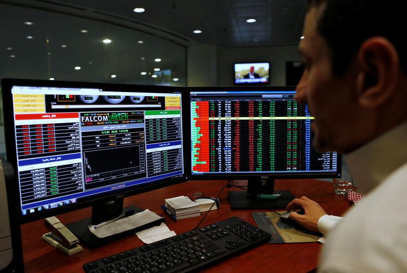 A Saudi trader observes the stock market on monitors at Falcom stock exchange agency in Riyadh