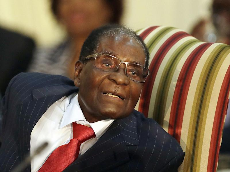 Zimbabwean President Robert Mugabe has long been criticised at home for going overseas for medical treatment and for presiding over the collapse of his country's healthcare system: AP/Themba Hadebe