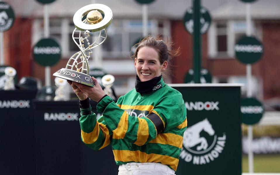 Rachael Blackmore with the Grand National trophy - PA