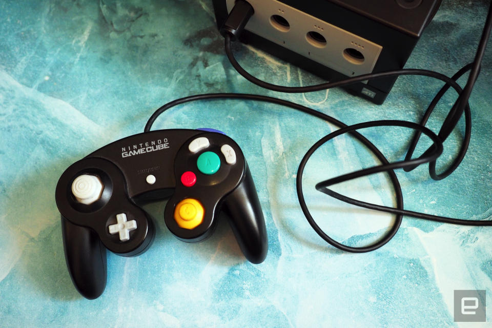 <p>Nintendo GameCube, black version with controller and games</p>