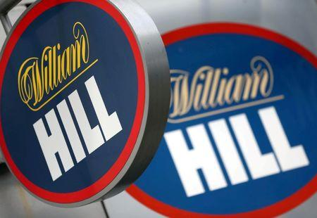 FILE PHOTO:A branded sign is displayed outside a William Hill betting shop in London