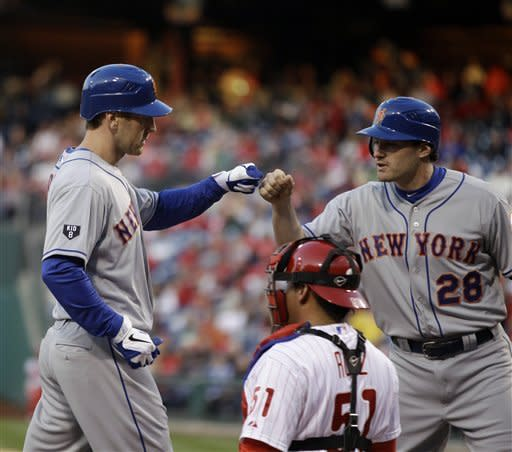 New York Mets' Jason Bay, left, and Daniel Murphy, right, celebrate after Bay's two-run home run in the first inning of a baseball game against the Philadelphia Phillies, Friday, April 13, 2012, in Philadelphia. Phillies catcher Carlos Ruiz, center, looks on. (AP Photo/Matt Slocum)