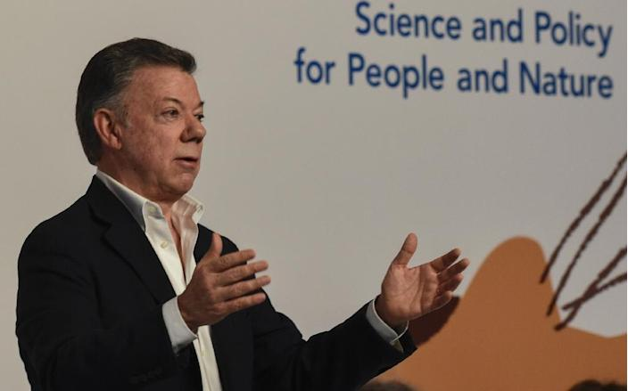 Colombian President Juan Manuel Santos delivers a speech during the opening of the sixth plenary session of the Intergovernmental Science-Policy Platform on Biodiversity and Ecosystem Services (IPBES) in Medellin (AFP Photo/Joaquin SARMIENTO)