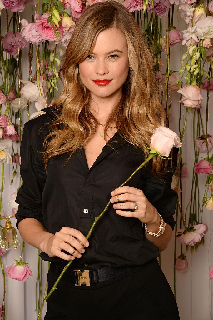 Behati Prinsloo poses with a rose