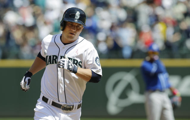 Seattle Mariners' Kyle Seager rounds the bases after hitting a home run in the fourth inning of a baseball game against the Kansas City Royals, Sunday, May 11, 2014 in Seattle. (AP Photo/Ted S. Warren)