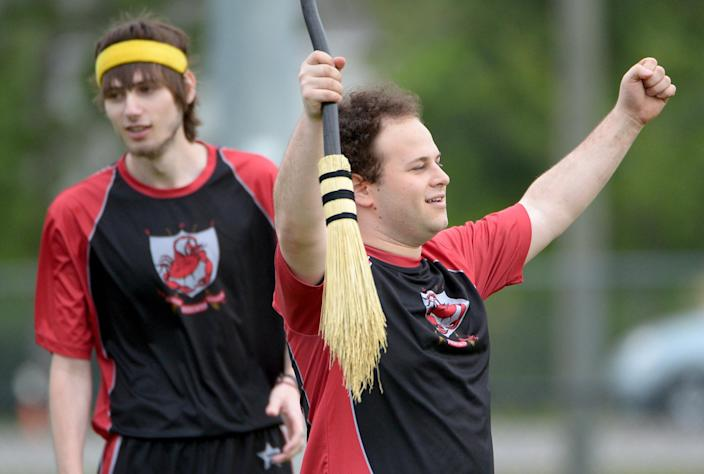 Silicon Valley Skrewts' Will Hack, right, and Craig Kaplan celebrate a score during a scrimmage against the University of Ottawa Quidditch team at the Quidditch World Cup in Kissimmee, Fla., Friday, April 12, 2013. Quidditch is a game born within the pages of Harry Potter novels, but in recent years it's become a real-life sport. The game is a co-ed, full contact sport that combines elements of rugby, dodgeball and Olympic handball.(AP Photo/Phelan M. Ebenhack)