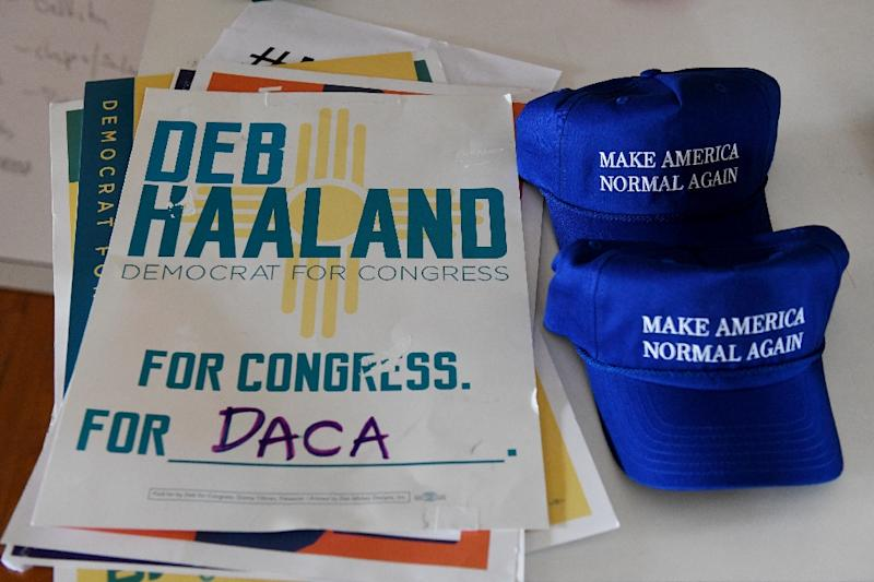 "Haaland's campaign baseball caps are a play on words from President Donald Trump's signature ""Make America Great Again"" hats (AFP Photo/Mark RALSTON)"