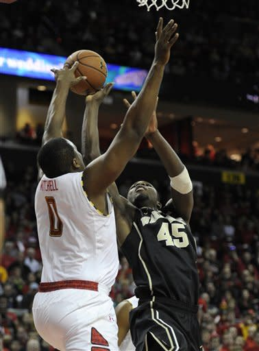 Wake Forest forward Arnaud William Adala Moto (45) goes to the basket against Maryland forward Charles Mitchell (0) during the first half of an NCAA college basketball game, Saturday, Feb. 2, 2013, in College Park, Md. (AP Photo/Nick Wass)