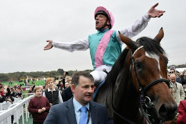 Dettori celebrates Enable's back-to-back Arc triumph in 2018 - the pair will return to Paris this autumn to bid for an historic third success in the Longchamp showpiece (AFP Photo/Philippe LOPEZ)
