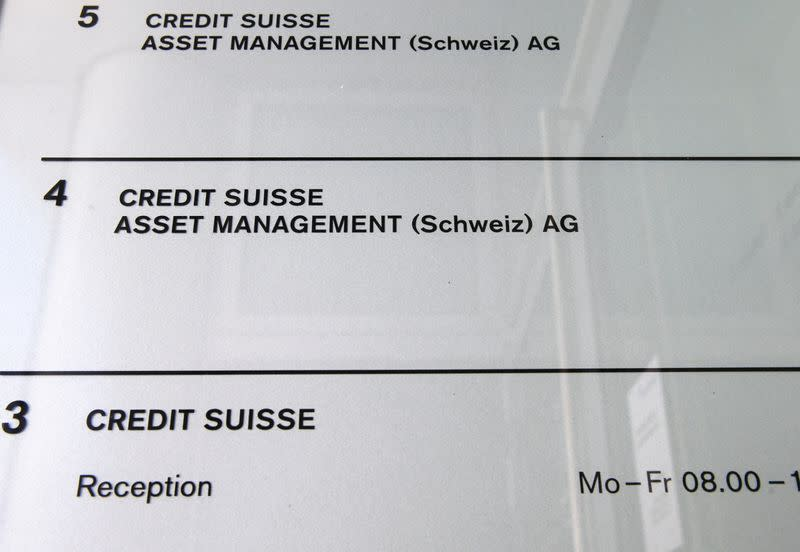 FILE PHOTO: Credit Suisse Asset Management is named at the entrance of an office building in Zurich